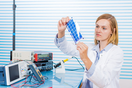 Solar technician working on solar cells