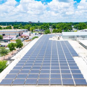 An array of solar panels on an urban rooftop
